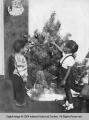 Children Hanging Ornaments