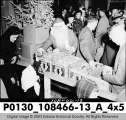 Santa Handing Out Fruit at Indianapolis Railways Christmas Party