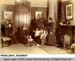 Women and Children by the Christmas Tree