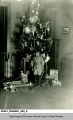 Young Boy Standing in Front of the Christmas Tree