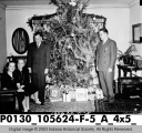 Dr. Newcomb Family in Front of Christmas Tree