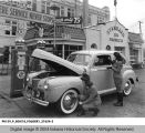 Car Being Checked at the Standard Oil Station