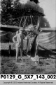 Louis Johnson Standing beside an Early Airplane.