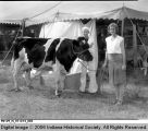 A Boy and Girl Stand with Their Dairy Cow at the Honey Creek High School Fair
