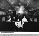 Passengers and African American Waiter in Union Traction Car