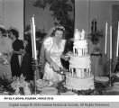 Daughter of N. H. Noyes Cutting Her Wedding Cake