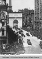 Automobiles Carrying Wounded Soldiers Passing Through Victory Arch