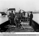 Men Unloading a Lifeboat from a Train During the 1937 Flood