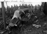 Train derailment, Engine no. 4913 and Pullmans, crumpled vehicle and crowd, 1937 (Bass #142530-G)