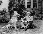 A. B. Christie and German sheperd dog, 30 July 1926 (Bass #97493-F)