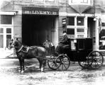 Horses and carriage outside C. H. Wood livery stable (no Bass #)