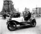Frank Moore (at wheel) at Monument Circle, for Pope Motor Car Company, 1908 (Bass #C-513)