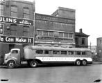 Greyhound Lines truck and bus, W. H. Bass Photo Co. Building, 1944 (Bass #263349F)