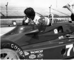 Goodyear Car #70, Dennis Firestone, driving talking to crew member (Keller Photo) (no Bass #)