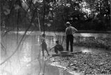 Two boys, one man, fishing, 1937 (Bass #142739F-12)