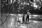 Two boys, one man, fishing, 1937 (Bass #142739F-2)