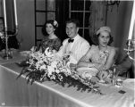 Wedding party, daughter of Nicholas H. Noyes, guests at table, 1938 (Bass # 102455F-11)