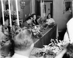 Wedding party, daughter of Nicholas H. Noyes, guests at table, 1938 (Bass # 102455F-15)