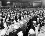 Group of men at banquet, men wear white hats and aprons (no Bass #)