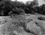 Estate of Nicholas H. Noyes, stream with view of grounds, circa 1931 (no Bass #)
