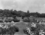 Estate of Nicholas H. Noyes, statue in garden with lillies blooming, 1931 (no Bass #)