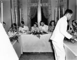 Wedding party, daughter of Nicholas H. Noyes, guests at table, waiter serving, 1938 (Bass # 102455F-14)