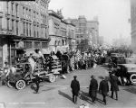 Victory Parade, Monument Circle street scene, crowd marching with flags, 1918 (Bass #64655-F)