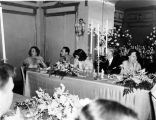 Wedding party, daughter of Nicholas H. Noyes, view of people at table, 1938 (Bass # 102455F-16]