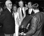 Howard S. Wilcox Inc. party, group singing along to accordion, 1969 (Bass #325668-2)
