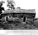 Log cabin built in 1831 by Thomas and Abraham Lincoln near Farmington, Illinois, 1936 (Bass #234806-F)