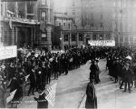 Victory Parade, Monument Circle street scene, crowd marching with flags, 1918 (Bass #64658-F)