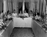 Wedding party, daughter of Nicholas H. Noyes, view of guests at table, 1938 (Bass # 102455F-18]
