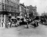 Victory Parade, Monument Circle street scene, crowd marching with flags, 1918 (Bass #646589-F)