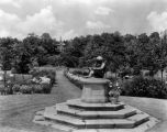 Estate of Nicholas H. Noyes, statue and garden with lillies blooming, 1931 (no Bass #)