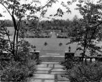Estate of Nicholas H. Noyes, view of grounds and statue from between two lanterns, 1931 (no Bass #)