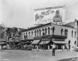 Illinois Street, police officer directing traffic, Levinson's store, Ambassador Theater, Lyric Theater,