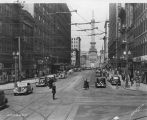 Meridian Street, Monument Circle, police officer directing traffic, 1936 (Bass #234263-F)