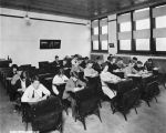 Public School no. 30, John McCormick, interior, children writing, 1924 (Bass #88950-F)