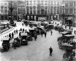 Monument Circle, cars on circle, crowd and photographer, 1908 (Bass #C-517)