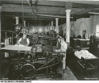 Arsenal Technical High School, interior, students operating printing press, 1915 (Bass #45052)