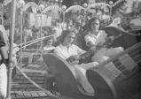 Indiana State Fair, young women on MIdway ride, 1937 (Bass #142758F-T)