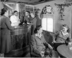 Barman, people at bar, [Illinois Central photograph] circa 1950 (no Bass #)
