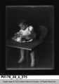Infant eating in a chair