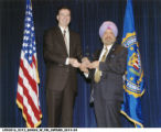 Singh Accepting an FBI Community Leadership Award