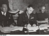 Lt. General Walter Bedell Smith signs the Unconditional German Surrender at Reims, France